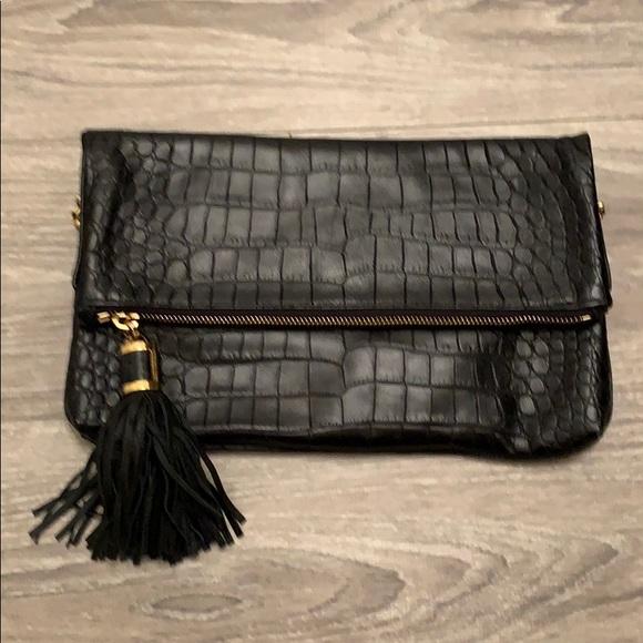 Michael Kors Handbags - Micheal Kors Black Leather Clutch.